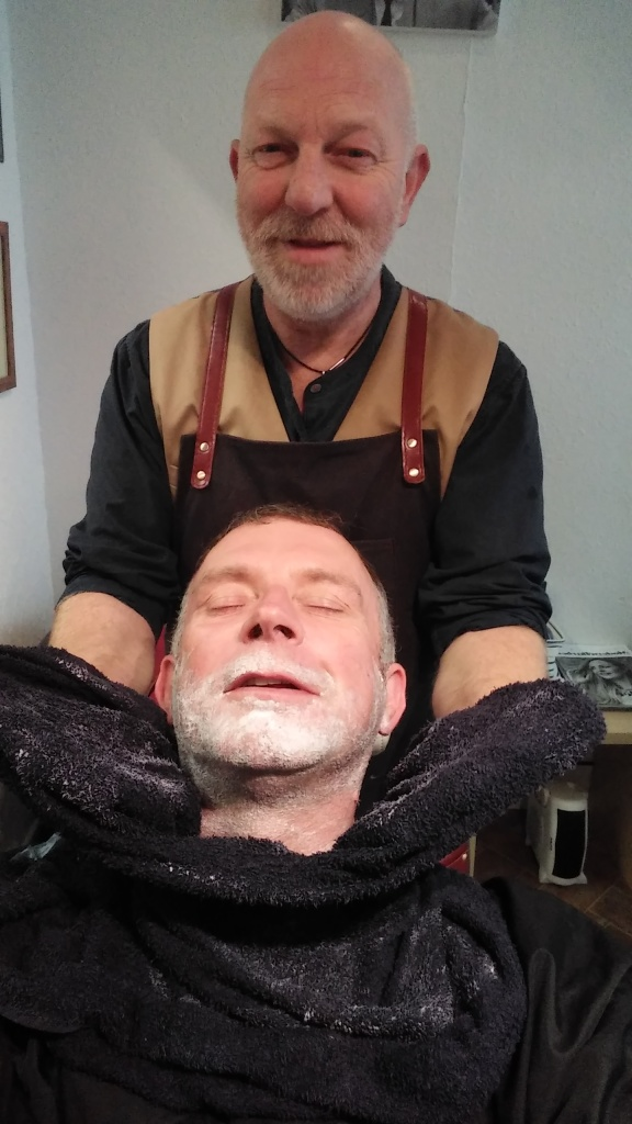 cut throat shaving jon davey in chair